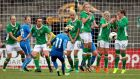 Ireland' players defend a free kick. Photograph: Ryan Byrne/Inpho