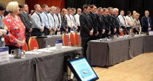 AGSI members stand for a minute's silence in tribute to the crew of Irish Coast Guard helicopter Rescue 116 at their conference in Killarney on Monday. Photograph: Don MacMonagle