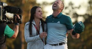 Sergio Garcia with  fiancee Angela Akins  after winning the US Masters in a sudden death playoff over Justin Rose on Sunday. Photograph: Andrew Gombert/EPA