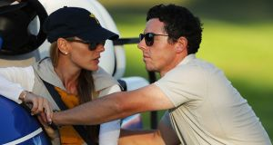 Erica Stoll and Rory McIlroy of Europe look on during afternoon fourball matches of the 2016 Ryder Cup. Photograph: Getty Images