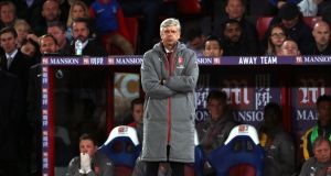 Arsene Wenger watches on after his side's latest defeat to Crystal Palace. Photo: Nick Potts/PA Wire