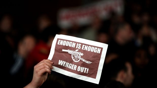 An Arsenal fan holds up a banner in protest against manager Wenger. Photo: Nick Potts/PA Wire