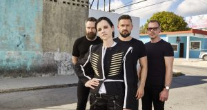 Cranberries lead singer Dolores O'Riordan, guitarist Noel Hogan, bassist Mike Hogan, and drummer Fergal Lawler