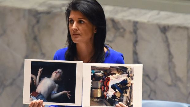 US ambassador to the UN Nikki Haley holds photos of victims of the chemical weapons attack in Syria at the UN Security Council last week. Photograph: Timothy A Clary/AFP/Getty Images