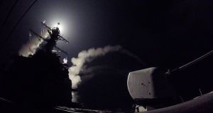 USS Porter  launching a missile strike while in the Mediterranean Sea, 07 April 2017. The United States military launched at least 50 tomahawk cruise missiles against al-Shayrat military airfield near Homs, Syria, in response to the Syrian military's alleged use of chemical weapons in an airstrike in a rebel held area in Idlib province. EPA/US NAVYEPA/US NAVY