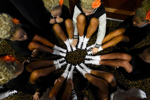 A dance group have a team meeting before performing on stage in the under 13s category. Photograph: Clodagh Kilcoyne/Reuters