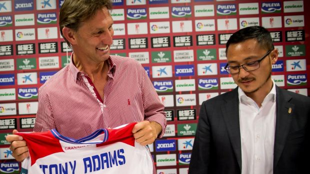Adams holds a Granada jersey next to the club's vice-president Kangning Wang. Photo: Pepe Marin/Reuters