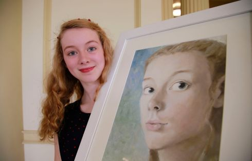 Meabh Scahill, Sutton, Dublin and her self portrait, which won 1st place in the 14/15 category.  Photograph: Nick Bradshaw
