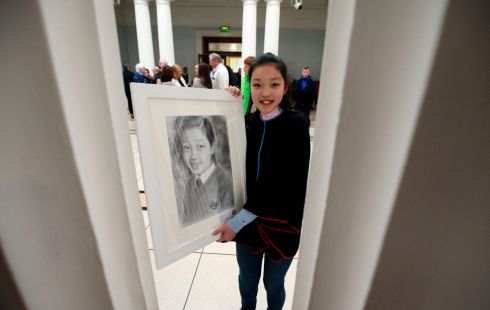 Amy Hao from Athlone, Westmeath with her pencil self-portrait.  Amy took 1st place  in the 12/13 category.  Photograph: Nick Bradshaw