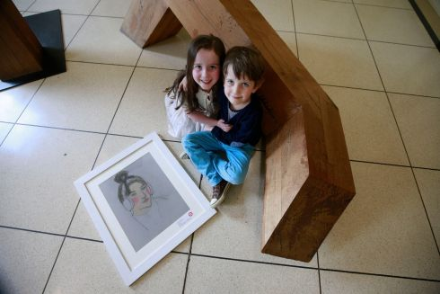 Noah James Flynn from Galway with his portrait of his sister Ruby May.  Noah was 1st in the 7/8 category.  Photograph: Nick Bradshaw
