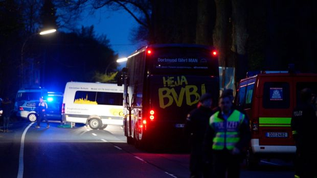 The Borussia Dortmund bus after it was damaged by an explosion before their Champions League clash with Monaco. Photo: Sascha Schuermann/Getty Images
