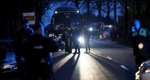 Head coach Thomas Tuchel of Borussia Dortmund stands near the team bus after it  was hit by  an explosion  in Dortmund, Germany. Photograph: Maja Hitij/Getty Images