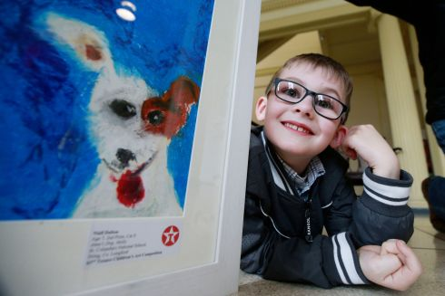 DOG DAY: Niall Dalton at the 63rd Texaco Children's Art Competition in the Hugh Lane Gallery on Parnell Square with his painting Anne's Dog, Molly.  Niall was second in the eight to nine age category.  Photograph Nick Bradshaw