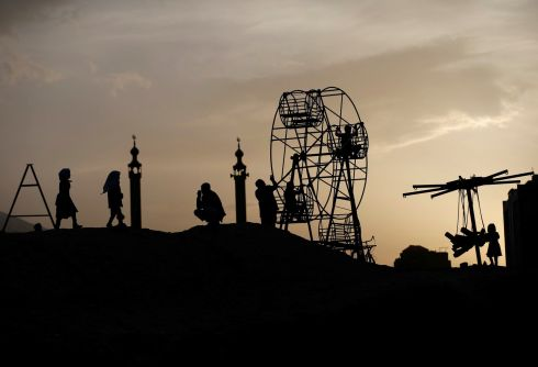 AT PLAY: Afghan children on a manually operated ferris wheel in Kabul, Afghanistan. Photograph: Mohammad Ismail/Reuters