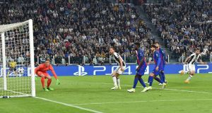 Juventus' Giorgio Chiellini scores his side's third goal in their Champions League quarter-final clash with Barcelona. Photo: Andrea Di Marco/EPA