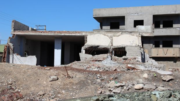 A house in Cudi, Cizre, badly damaged in the military operation by Turkish forces last year. Many families in the area have abandoned their homes since the conflict. Photograph: Stephen Starr