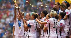 Carli Lloyd   lifts the trophy as the USA celebrate winning the Women's World Cup in 2015. Photograph: Ben Nelms/EPA