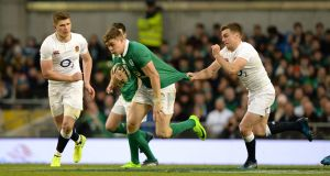 England's George Ford grabs a fistful of jersey to prevent Garry Ringrose making a clean  break at the Aviva Stadium. Photograph: Dara Mac Dónaill