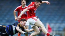 Cork's Mark Cronin scores a goal despite the attempted challenge of Tipperary's Jack Dolan during the Electric Ireland Munster MFC quarter-final at Semple Stadium in Thurles. Photograph:  Tommy Dickson/Inpho