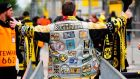 A Dortmund fan wearing dozens of scarves passes the security check before entering the stadium for the Borussia  Dortmund-Monaco Champions League match.  Norbert Schmidt/AFP/Getty Images