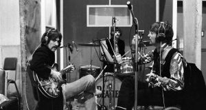 George Harrison, Ringo Starr and John Lennon during the recordings of Sgt Pepper's Lonely Hearts Club Band. Photograph:  Henry Grossman/Govinda Gallery/Washington Post