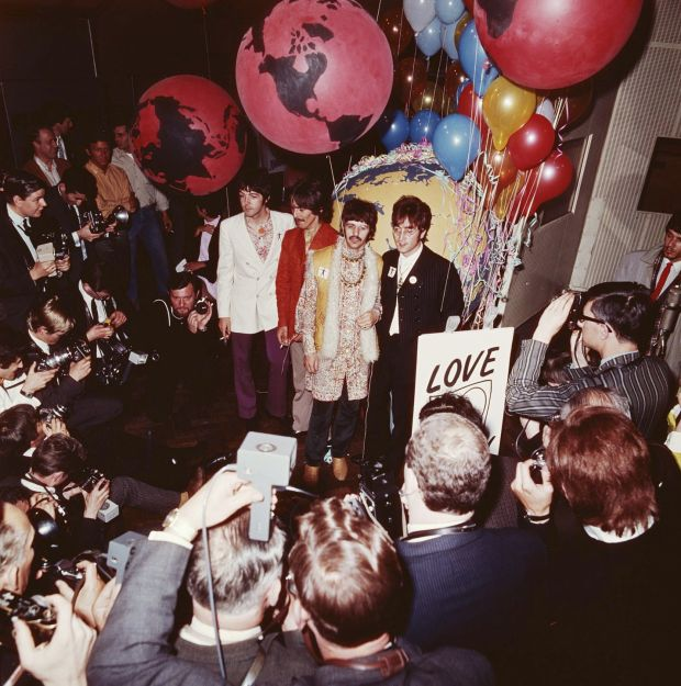 George Harrison, Ringo Starr and John Lennon of The Beatles pose in front of the press at Abbey Road Studios in London in 1967, the year Sgt Pepper's was released. Photograph: David Redfern/Redferns