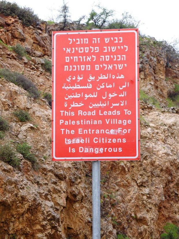 A warning sign about entering a Palestinian village. Photograph: Eimear McBride