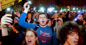 People shout slogans against Hungarian prime minister Viktor Orban's government in front of the parliament building in Budapest on Wednesday night. Photograph: Attila Kisbenedek/AFP/Getty Images