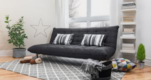 Strategically placed accessories can make a shabby sofa look rather Scandi