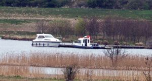 The boat involved in the tragedy moored at the rear of Devenish Island along with a police boat. Photograph: Ronan McGrade/Pacemaker