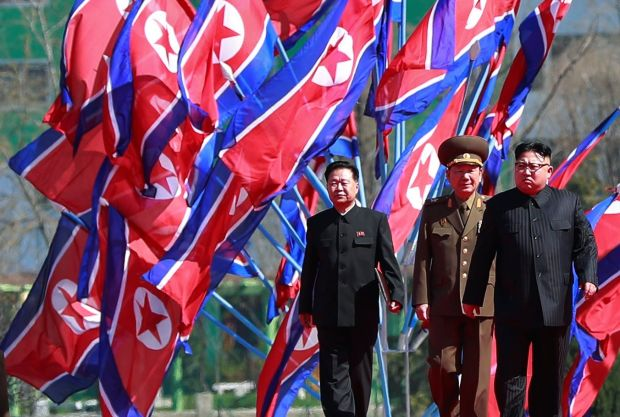 North Korean leader Kim Jong-un (far right). Washington wants Beijing to rein in the North Korean leader. Photograph: How Hwee Young/EPA