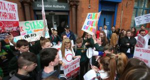 "Irish language protesters outside the Education Authority on Academy Street in Belfast. ""We are not asking for everybody to speak Irish. The language is there for all who want it."" Photograph:    Colm Lenaghan/Pacemaker"