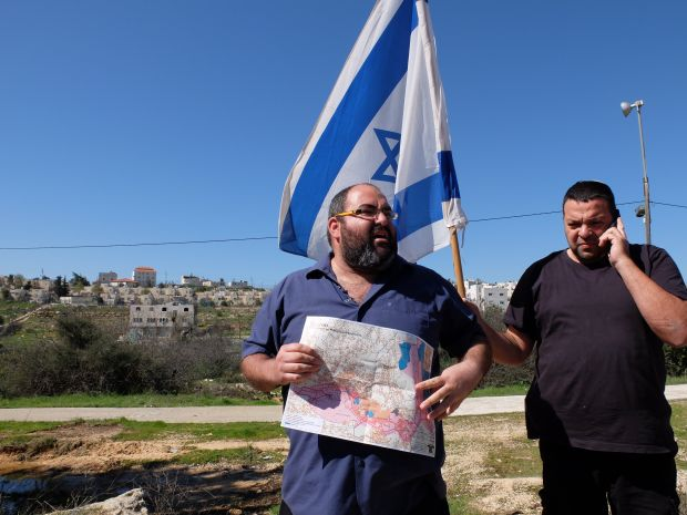 Hebron, at the grave of Baruch Goldstein, Yehuda Shaul from Breaking the Silence describes the massacre perpetrated by Goldstein, against 29 Muslim Palestinians in a mosque in 1994, while being harassed by local settlers. Photograph: Eimear McBride