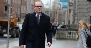 Minister for Housing, Planning and Local Government Simon Coveney:  a Co Cork community group has criticised him for failing to introduce legislation for large-scale solar farms. Photograph: Dara Mac Dónaill