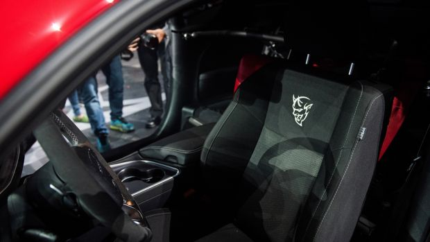 The Dodge Challenger SRT Demon takes the already-ridiculously-powerful 710bhp 6.2-litre supercharged V8 engine from the Challenger Hellcat, and cranks it into full-blown insanity for an output of 850bhp. Photograph: Julie Jacobson