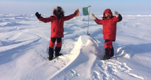 Irish flag unfurled at North Pole:  Wicklow climbers Bill Roberts and Myles Campion complete their difficult trek.