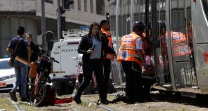 Emergency services and police at the scene of the stabbing in Jerusalem, Israel. Photograph: Mahmoud Illean/AP Photo