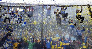 Boca Juniors fans can't contain their excitement during a 2014 match against River Plate in Buenos Aires. Photograph: Daniel/AFP/Getty Images