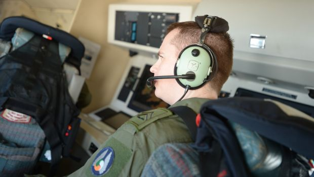 Corporal Keith Mooney on board the Air Corps' Casa maritime surveillance plane. Photograph: Jamie Martin/Irish Air Corps