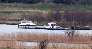 The boat involved in the Lough Erne tragedy moored at the rear of Devenish Island along with a police boat. Photograph: Ronan McGrade/Pacemaker