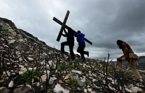 GOOD FRIDAY: The cross is carried to Bray Head during the Stations of the Cross from Our Lady Queen of Peace Church. Photograph: Cyril Byrne