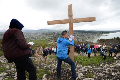 GOOD FRIDAY: Donal McMahon with the cross  on Bray Head during the Stations of the Cross  ceremony from Our Lady Queen of Peace Church. Photograph: Cyril Byrne