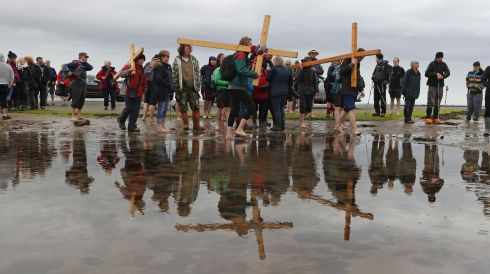 CARRYING THE CROSS: Pilgrims carry crosses to the Holy Island of Lindisfarne in Northumberland during the annual Christian Easter pilgrimage on Good Friday. Photograph: PA