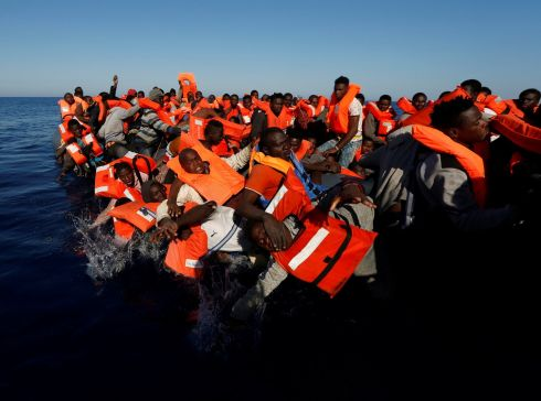 MIGRANT CRISIS: Migrants fall off their rubber dinghy during a rescue operation by the Malta-based NGO Migrant Offshore Aid Station ship in the central Mediterranean. Photograph: Reuters
