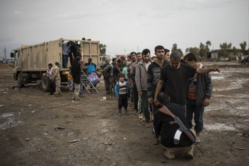 BATTLE FOR MOSUL: Displaced Iraqi men arrive at a processing center in western Mosul . Photograph: Getty Images