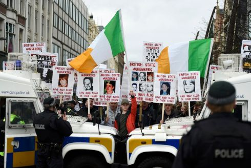 TWO TRIBES: Armoured police vehicles seperate demonstrations in Belfast. Photograph: Reuters