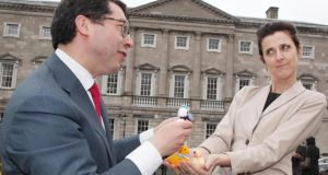 Senator Rónán Mullen presents an Easter chicken to Senator Michelle Mulherin outside Leinster House. Photograph: John Mc Elroy.