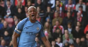 Manchester City's  Vincent Kompany celebrates scoring a goal against Southampton during the  Premier League match at   St Mary's stadium. Photograph: Facundo Arrizabalaga/EPA