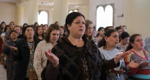 Christians celebrate Mass in Mar Gewargis (St George) Chaldean Catholic church, which was damaged by Islamic State militants, in the town of Tel Esqof, Iraq. Photograph: Reuters