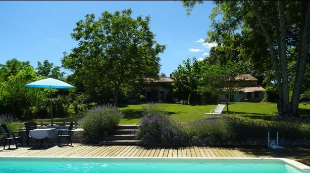 Dordogne in France: a three-bedroomed farmhouse and a two-bedroom guest house with a lawn that runs down to a swimming pool